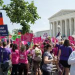 Washington DC, USA - June 27, 2016: Pro-choice supporters stand in front of the U.S. Supreme Court after the court, in a 5-3 ruling in the case Whole Woman's Health v. Hellerstedt, struck down a Texas abortion access law.