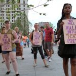Cleveland, Ohio, USA - July 21, 2016:  A group of women participate in the Longest Walk art installation to protest the policies contained in the Republican Party platform at the Public Square on the fourth and last afternoon of the Republican National Convention.  As evening approached, the action in the square became smaller in scale and more personal.